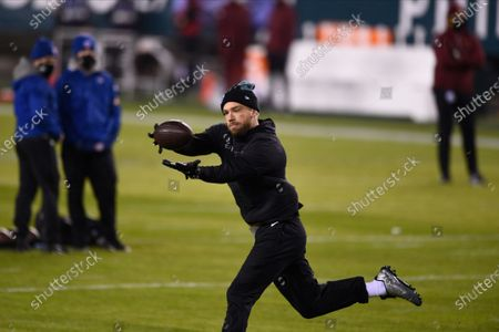 Philadelphia Eagles' Zach Ertz warms up before an NFL football game against the Washington Football Team, in Philadelphia