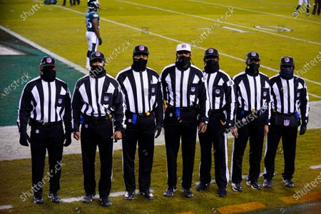 Stock Photo of Officials Patrick Holt (106), Greg Yette (38), Boris Cheek (41), Roy Ellison (81), Greg Bradley (98) and James Coleman (95) pose for a group portrait before an NFL football game between the Philadelphia Eagles and the Washington Football Team, in Philadelphia