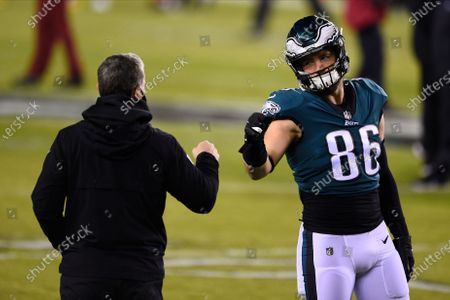 Philadelphia Eagles' Zach Ertz, right, and Jim Schwartz meet before an NFL football game against the Washington Football Team, in Philadelphia