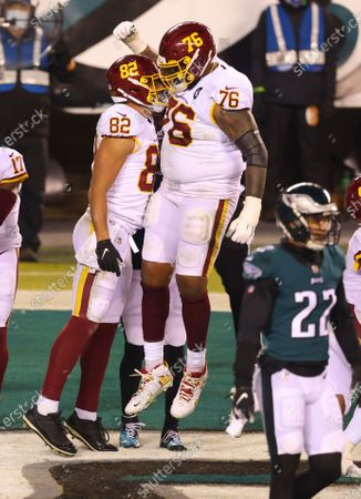 Washington Football Team's Logan Thomas (82) celebrates his touchdown catch with Morgan Moses (76) against the Philadelphia Eagles during the second quarter of an NFL football game, in Philadelphia
