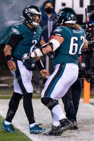Philadelphia Eagles quarterback Jalen Hurts (2) celebrates his touchdown with center Jason Kelce (62) during the NFL football game against the Washington Football Team, in Philadelphia