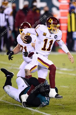 Washington Football Team's Alex Smith (11) is tackled by Philadelphia Eagles' Malik Jackson (97) during the second half of an NFL football game, in Philadelphia