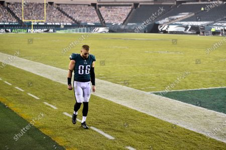 Philadelphia Eagles' Zach Ertz walks to the locker room after an NFL football game against the Washington Football Team, in Philadelphia