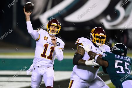 Washington Football Team's Alex Smith plays during the first half of an NFL football game against the Philadelphia Eagles, in Philadelphia