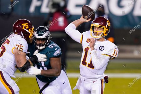 Washington Football Team's Alex Smith passes during the first half of an NFL football game against the Philadelphia Eagles, in Philadelphia