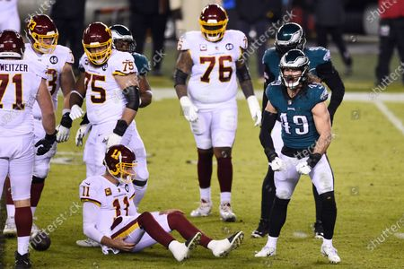 Philadelphia Eagles' Alex Singleton (49) reacts after tackling Washington Football Team's Alex Smith (11) during the first half of an NFL football game, in Philadelphia