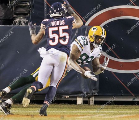 Green Bay Packers tight end Marcedes Lewis (R) fails to catch a pass in front of Chicago Bears linebacker Josh Woods (L) in the end zone during the American football game between the Green Bay Packers and the Chicago Bears at Soldier Field in Chicago, Illinois, USA, 03 January 2021.