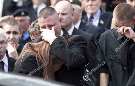 Mourners as they pay their respects to Guardsman Michael Sweeney in Wootton Bassett High Street as the cortege comes through the Wiltshire town.