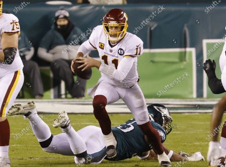 Washington Football Team quarterback Alex Smith runs out of the pocket in the second half against the Philadelphia Eagles in week 17 of the NFL season at Lincoln Financial Field in Philadelphia. Washington defeated the Eagles 20-14 and win the NFC East Division with a record of 7-9.