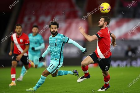 Liverpool's Mohamed Salah (L) in action against Southampton's Jack Stephens (R) during the English Premier League soccer match between Southampton and Liverpool in Southampton, Britain, 04 January 2021.