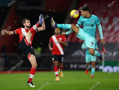 Southampton's Jack Stephens (L) in action against Liverpool's Roberto Firmino (R) during the English Premier League soccer match between Southampton and Liverpool in Southampton, Britain, 04 January 2021.