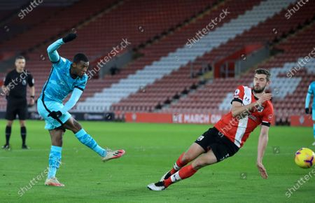 Jack Stephens (L) of Southampton in action against Georginio Wijnaldum (R) of Liverpool during the English Premier League soccer match between Southampton and Liverpool in Southampton, Britain, 04 January 2021.