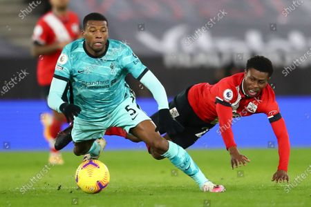 Liverpool's Georginio Wijnaldum (L) in action against Southampton's Nathan Tella (R) during the English Premier League soccer match between Southampton and Liverpool in Southampton, Britain, 04 January 2021.