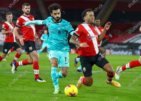 Liverpool's Mohamed Salah, left, and Southampton's Ryan Bertrand collide as they compete for the ball during the English Premier League soccer match between Southampton and Liverpool at St Mary's Stadium, Southampton, England