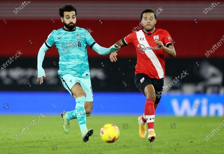 Stock Image of Liverpool's Mohamed Salah, left, and Southampton's Ryan Bertrand compete for the ball during the English Premier League soccer match between Southampton and Liverpool at St Mary's Stadium, Southampton, England
