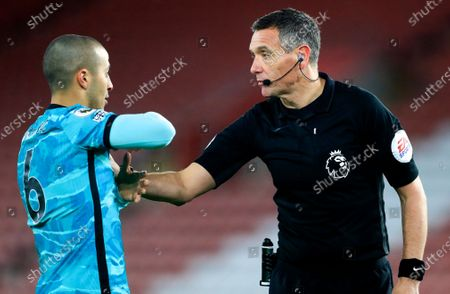 Stock Picture of Referee Andre Marriner talks with Liverpool's Thiago Alcantara during the English Premier League soccer match between Southampton and Liverpool at St Mary's Stadium, Southampton, England