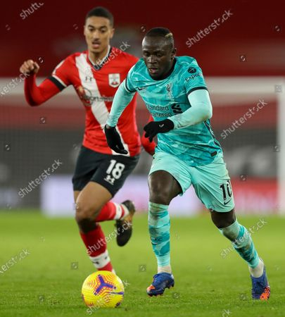 Liverpool's Sadio Mane, right, takes the ball away from Southampton's Yan Valery during the English Premier League soccer match between Southampton and Liverpool at St Mary's Stadium, Southampton, England