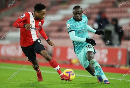 Liverpool's Sadio Mane, right, and Southampton's Kyle Walker-Peters battle for the ball during the English Premier League soccer match between Southampton and Liverpool at St Mary's Stadium, Southampton, England