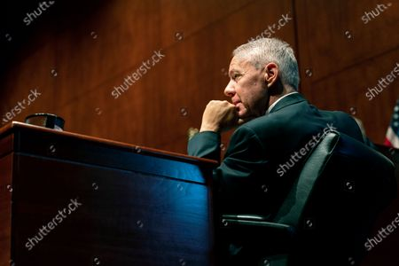 Rep. Ken Buck, R-Colo., listens during a hearing on Capitol Hill in Washington. Colorado U.S. Rep. Doug Lamborn, joined the state's newest member of Congress, Republican Lauren Boebert, in saying he will vote against certifying Democrat Joe Biden's presidential election victory in a joint session of Congress on Wednesday, Jan. 6. Lamborn's announcement deepened a rift in the state's Republican party, whose outgoing chair, Buck, said in a statement issued Sunday, Jan. 3 that he won't join dissident Republicans in challenging the states' electoral votes, noting that the Constitution doesn't give Congress the authority to do so