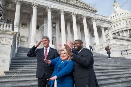 Stock Photo of United States Representative Scott Franklin (Republican of Florida), United States Representative Kat Cammack (Republican of Florida), United States Representative Carlos Gimenez (Republican of Florida) and United States Representative Byron Donalds (Republican of Florida) pose for a personal photo after joining other freshmen GOP members of Congress for a group photograph on the East Front Steps of the U.S. Capitol in Washington, DC,.