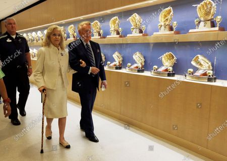 Stock Photo of Los Angeles Dodgers Hall of Fame broadcaster Vin Scully, right, and his wife, Sandra Hunt Scully, walk past a display of Dodgers awards as they head for a ceremony where Vin Scully was to be honored before a baseball game against the Colorado Rockies at Dodger Stadium. The Los Angeles Dodgers say Sandra Scully died, at age 76. She had been dealing with the neuromuscular disease ALS over the last several years and died at Ronald Reagan UCLA Medical Center in Los Angeles. She and Vin Scully celebrated their 47th wedding anniversary in 2020