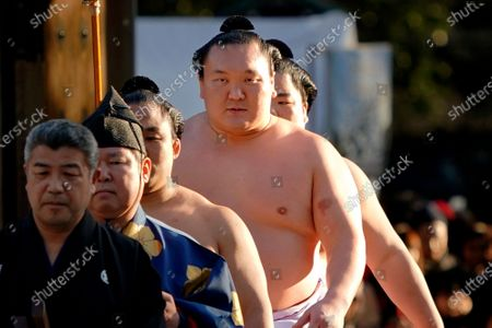 Sumo grand champion Hakuho, second from right, of Mongolia arrives to perform his ring entry form at the Meiji Shrine in Tokyo. Hakuho, the top-ranked sumo wrestler in Japan has tested positive for the coronavirus, the Japan Sumo Association said on