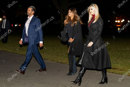 From left, Donald Trump Jr., the son of President Donald Trump, his girlfriend, Kimberly Guilfoyle, and Ivanka Trump, the daughter of President Donald Trump, arrive at the White House in Washington, early, after returning with the president from a rally in Dalton, Ga