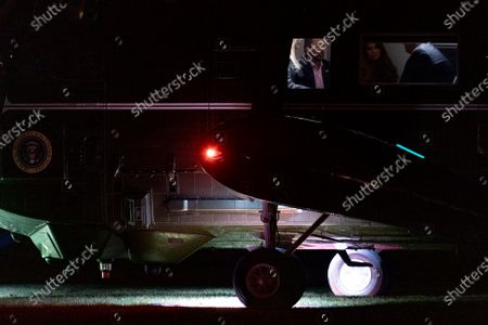 From left, Ivanka Trump, the daughter of President Donald Trump, Donald Trump Jr., the son of President Donald Trump, his girlfriend, Kimberly Guilfoyle, and President Donald Trump arrive in the early morning hours, at the White House in Washington, after returning from a rally in Dalton, Ga