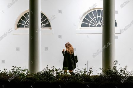 Kimberly Guilfoyle, the girlfriend of Donald Trump Jr., walks along the Colonnade towards the West Wing as she arrives in the early morning hours at the White House in Washington, after returning with President Donald Trump from a rally in Dalton, Ga