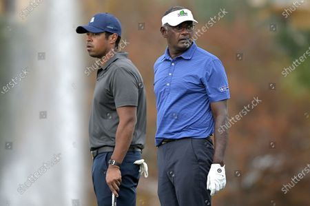 Vijay Singh, right, of Fiji Islands, and his son Qass wait to putt on the 18th green during the final round of the PNC Championship golf tournament, in Orlando, Fla