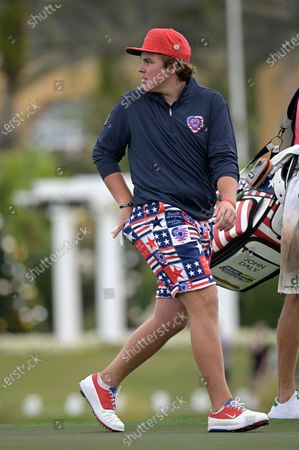 Little John Daly, son of golfer John Daly, walks off the 18th green after finishing during the final round of the PNC Championship golf tournament, in Orlando, Fla