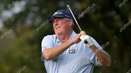 Stock Photo of Mark Calcavecchia watches his tee shot on the fourth hole during the final round of the PNC Championship golf tournament, in Orlando, Fla