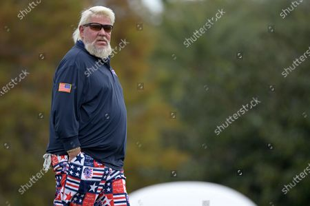 John Daly walks off the 18th green after finishing during the final round of the PNC Championship golf tournament, in Orlando, Fla
