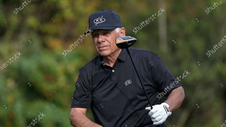 Lee Trevino watches his tee shot on the first hole during the final round of the PNC Championship golf tournament, in Orlando, Fla