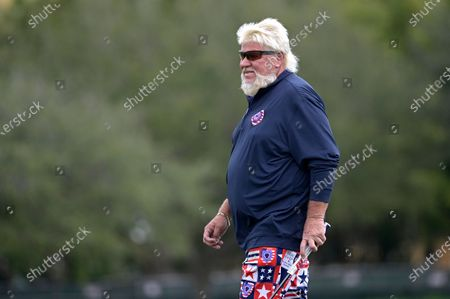 John Daly sets up to putt on the 18th green during the final round of the PNC Championship golf tournament, in Orlando, Fla