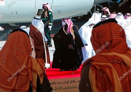 Saudi Crown Prince Mohammed bin Salman, center right, greets the Emir of Qatar Sheikh Tamim bin Hamad Al Thani, as he arrives at Al Ula airport, where the 41st Gulf Cooperation Council (GCC) take place in Saudi Arabia, . Al Thani's arrival in the kingdom's ancient desert city of Al-Ula on Tuesday was broadcast live on Saudi TV. He was seen descending from his plane and being greeted with a hug by the Saudi crown prince. The diplomatic breakthrough comes after a final push by the outgoing Trump administration and fellow Gulf state Kuwait to mediate an end to the crisis