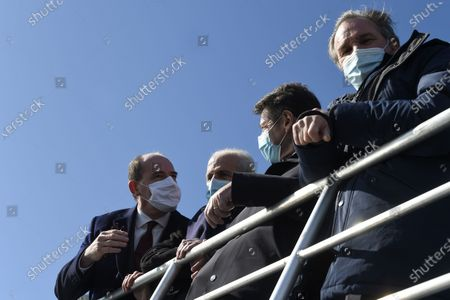 French Prime Minister Jean Castex (L) makes a boat tour of Toulon's bay with Toulon's mayor Hubert Falco (C), Nice's mayor Christian Estrosi (2ndR) and president of Paca region Renaud Muselier (R) following the signing of a state-region plan contract, on January 5, 2021 in Toulon.