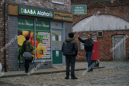 Coronation Street - Ep 10221 Wednesday 13th January 2021 - 1st Ep Asha Alahan, as played by Tanisha Gorey, and Aadi Alahan, as played by Adam Hussain, are underwhelmed with their big birthday present, their initials added to the corner shop sign! Also pictured - Dev Alahan, as played by Jimmi Harkishin.