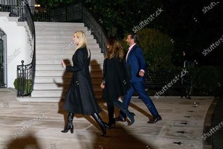 First Daughter and Advisor to the President Ivanka Trump, Donald Trump Jr. and Kimberly Guilfoyle return to the White House after a visit to Dalton, Georgia, in Washington D.C., U.S.,. Photographer: Erin Scott/Bloomberg