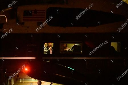 First Daughter and Advisor to the President Ivanka Trump, Donald Trump, Jr, and Kimberly Guilfoyle speak to United States President Donald J. Trump as they return to the White House aboard Marine One after a visit to Dalton, Georgia, in Washington D.C., U.S.,.