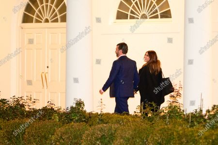 Donald Trump Jr. and Kimberly Guilfoyle walk on the Colonnade as they return to the White House after a visit to Dalton, Georgia, in Washington D.C., U.S.,. Photographer: Erin Scott/Bloomberg