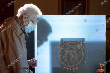 Helen Thomason marks her ballot at the Lawrenceville Road United Methodist Church in Tucker, Ga. during the Senate runoff election Tuesday morning
