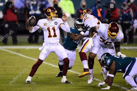 Washington Football Team's Alex Smith plays during the first half of an NFL football game against the Philadelphia Eagles, in Philadelphia. Alex Smith is the biggest reason Washington became the first team in the Super Bowl era to start 2-7 and make the playoffs. The 36-year-old's journey back from a broken leg and 17 surgeries was a long one, but the difference with him at quarterback has been simple: Smith doesn't make major mistakes, manages the game and is the cool hand coach Ron Rivera wanted in control of his young team