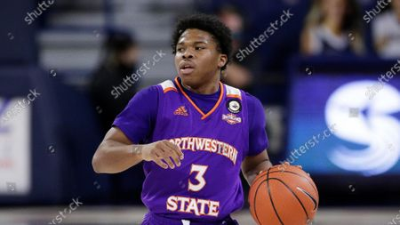 Northwestern State guard Brian White brings the ball up the court during the first half of an NCAA college basketball game against Gonzaga in Spokane, Wash