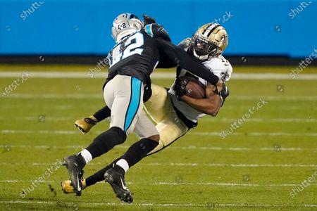 Carolina Panthers safety Sam Franklin (42) tackles New Orleans Saints wide receiver Emmanuel Sanders (17) during an NFL football game in Charlotte, N.C