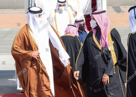 Saudi Arabia's Crown Prince Mohammed bin Salman Al Saud (R) welcomes Qatari Emir Sheikh Tamim bin Hamad Al Thani in Al-Ula, Saudi Arabia, Jan. 5, 2021. Qatari Emir Sheikh Tamim bin Hamad Al Thani arrived on Tuesday in Saudi Arabia's Al-Ula to attend the 41st Gulf Cooperation Council (GCC) Summit, Al Arabiya TV reported.    It is his first visit to the kingdom since the beginning of the Gulf crisis more than three years ago.