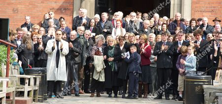 Mourners including Franco Nero (white coat on the left)