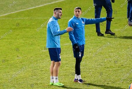 Schalke's new defender Sead Kolasinac, left, talks to Amine Harit, right, during a late training session in Gelsenkirchen, Germany, . Kolasinac is a loan from Arsenal in London to help the traditional Bundesliga club in their Relegation battle. After failing to win in 30 straight matches in the German league, stretching back to last season, FC Schalke 04 is now only one game away from matching the all-time record set by Tasmania Berlin in the 1965-66 season