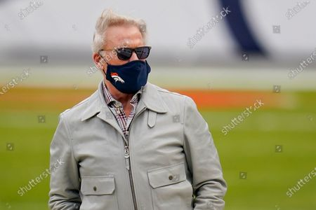 John Elway looks on before the start of a game between the Denver Broncos and the Las Vegas Raiders, in Denver