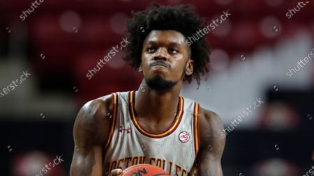 Boston College's CJ Felder plays against Louisville during the second half of an NCAA college basketball game, in Boston